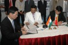 Mr. Mansukh Patel (Chairmen) Signing MOU under MOU Signing Ceremony between India & China